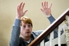 Rupert_Grint_(Tony)_looking_over_the_banisters_with_his_hands_raised_[3358_Photo__Nick_Wall].jpg